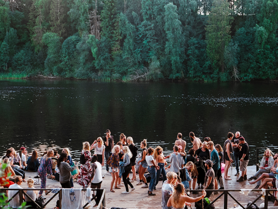 crowd by a lake